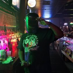 Image of the bartender saluting the camera