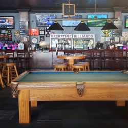 Im age of Pool Table and Surrounding Bar