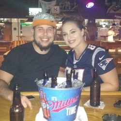 Image of Couple with Beer Bucket In Front of them