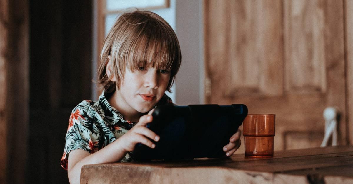 Photo of a boy playing on an ipad by Annie Spratt on Unsplash