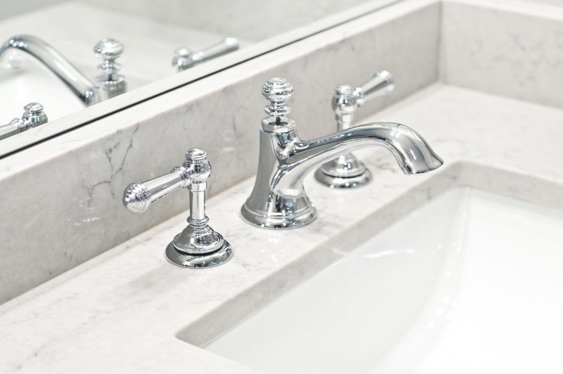 marble counters with chrome faucet