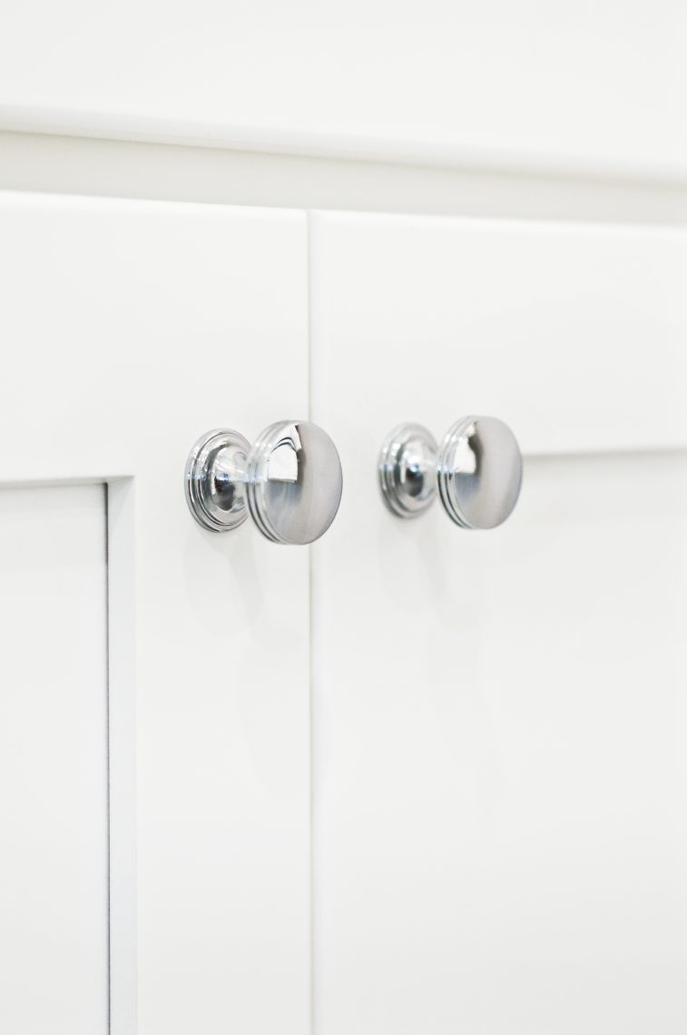 Shiny Chrome Hardware on White Cabinets for New Bathrooms