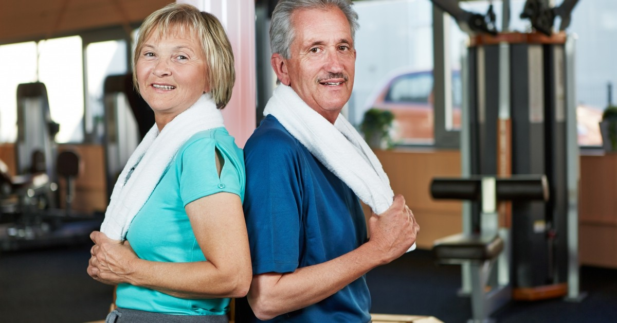 and elderly couple at the gym