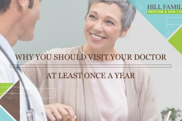 "An older woman smiles at a doctor while they talk with the words ""Why you should visit your doctor at least once a year."""