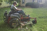 Worker on Riding Lawn Mower