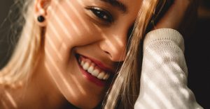 A young woman with healthy teeth and a beautiful smile.