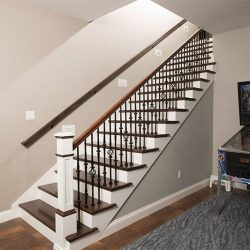 Custom stair handrail and hardwood staircase by Bailey Custom Woodworking.
