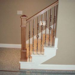 Custom stairs and wood banister by Bailey Custom Woodworking.