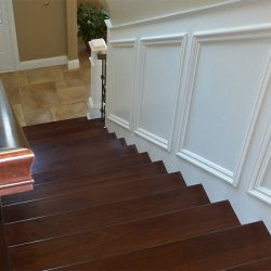 Stained wooden stairs by Bailey Custom Woodworking in Springfield, IL.