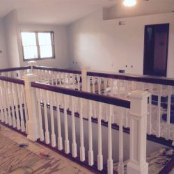 Painted wood banister and balusters by Bailey Custom Woodworking.