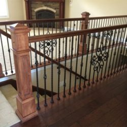 Modern wooden stairs and banister by Bailey Custom Woodworking.