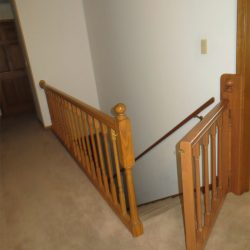 Wooden balusters and banister with gate by Bailey Custom Woodworking.