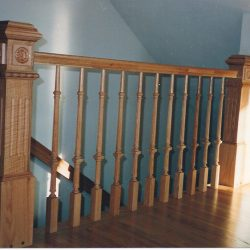 Rustic wooden balusters and banister by Bailey Custom Woodworking.