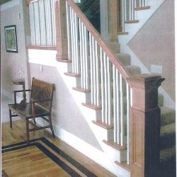 Contemporary wood stairs with white painted balusters by Bailey Custom Woodworking.