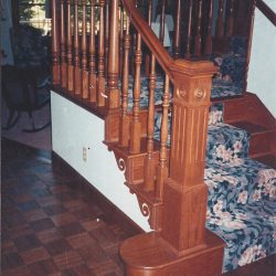 Unique stairwell and wooden balusters by Bailey Custom Woodworking.