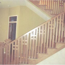 Boxy wooden balusters, banister, and staircase by Bailey Custom Woodworking.