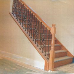 Wooden staircase and banister by Bailey Custom Woodworking.