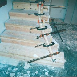 Wood stairs and banister being built by Bailey Custom Woodworking.