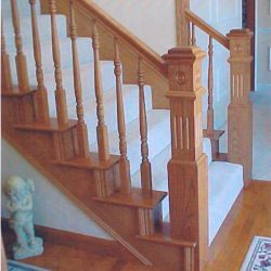 Intricate wood balusters and banister by Bailey Custom Woodworking.