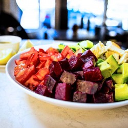Beet salad with grilled chicken from our burger bar menu.