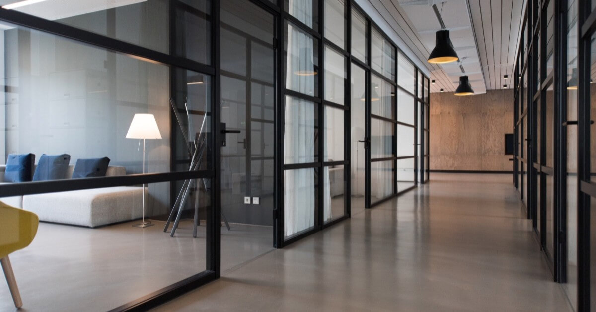 Chic, modern office with individual offices divided by glass panels