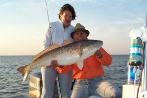 Capt. Clay Showing Off Her 1st Bull Red