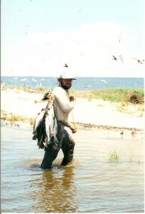 Capt. Clay Bring A Stringer Of Speckled Trout To The Beach