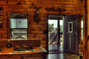 This is a photo of the living room of one of our beautiful log cabins at Bayou Log Cabins