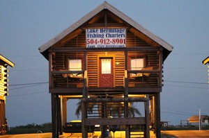 luxury-fish-cabins This is one of our log cabins on Lake Hermitage Bayou that you can spend the night when you book a speckled trout and red fish charter at Bayou Log Cabins LLC