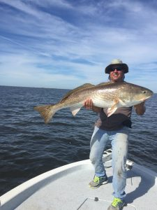 Capt. Clay With A Big Bull Red