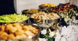 An assortment of dishes served buffet-style in a catered event.