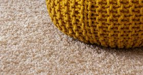 Photo of a pillow on a carpet by Ran Berkovich on Unsplash