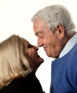 Request-an-Assessment_senior-couple_blue-sweater_white-background