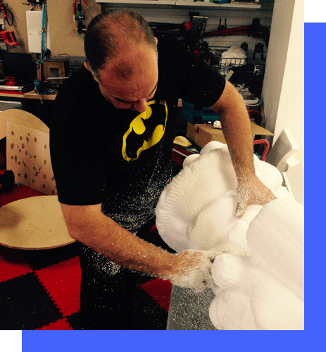 Man carving out a foam prop