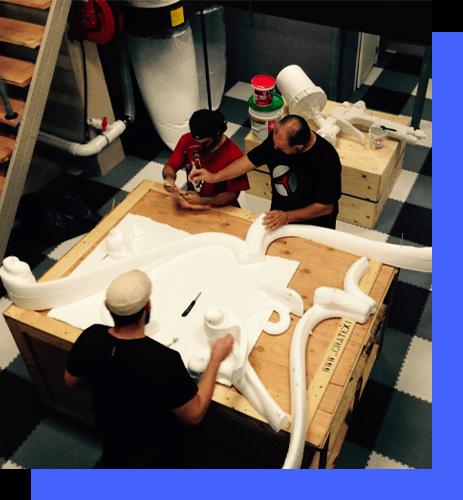 Overhead photo of men working on foam props