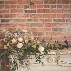 A Beautiful Antique Mantle Decorated With Wedding Flowers