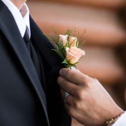 A Beautiful Boutonniere Being Put On