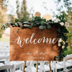 A Wedding Welcome Sign With A Garland Accent.