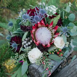 A high texture bouquet featuring a stunning King Protea by Bliss.