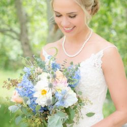 A bride & her blue bridal bouquet.
