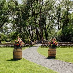 Stunning barrel arrangements framing a wedding entrance.
