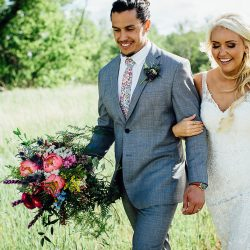 A beautiful bride and groom with a gorgeous Bliss bridal bouquet!