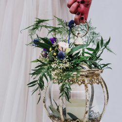 A Bliss rental lantern decorated with stunning floral.
