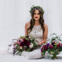 A bride sitting with her amazing Bliss wedding flowers.