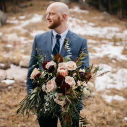 A Groom Holding Her Stunning Bouquet