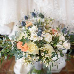 A Gorgeous Bridal Bouquet At Her Feet