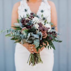 A stunning bride and her bouquet by Fort Collins best wedding florist.