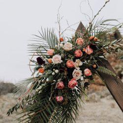 A stunning arch spray by Fort Collins best wedding florist.