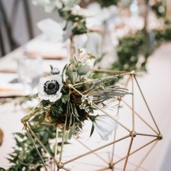 Geometric centerpieces by Bliss Wedding Florist.