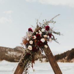 Stunning wood triangle arch from Bliss Wedding Florist.